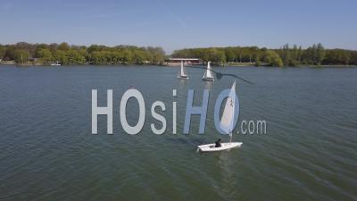 Small Sailboats Sailing On A Lake - Video Drone Footage