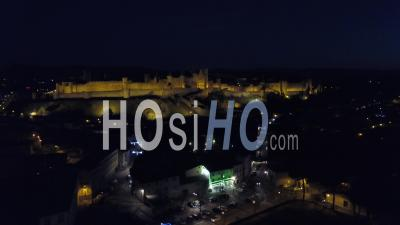 Carcassonne Old City Illuminated At Nightfall, Seen By Drone