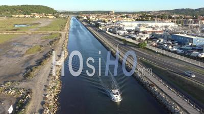 Motor Boat On A Canal In France, Aerial View By Drone