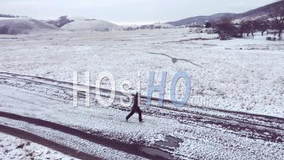 Woman Running In A Cold Morning Viewed From Drone