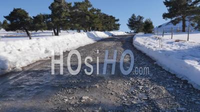 Country Road And French Alps Mountains In The Snow At Ancelle Village, Hautes-Alpes, France – Aerial View By Drone