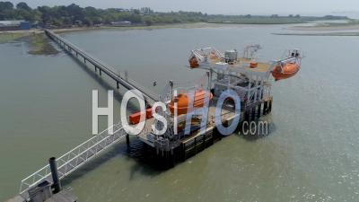 A Training Area Used For Crews On Small And Large Ships To Train For Emergencies And How To Safely Survive A Sinking Ship And Evacuation Process. Uk - Video Drone Footage