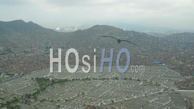 Lima Peru Flying Near Large Cemetery In El Agustino District Panning With Panoramic Views. - Video Drone Footage