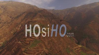 Peru Flying Backwards Down Mountain Hillsides - Video Drone Footage