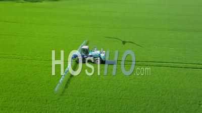 Aerial View Of A Tractor Spraying Field