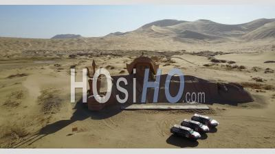 Giant Statue In The Middle Of Sand Dunes In The Gobi Desert In China