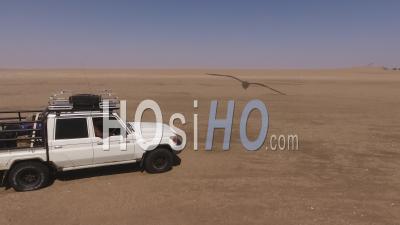 White Pick Up Driving To The Eduard Bohlen Ship Wreck, Namib Desert