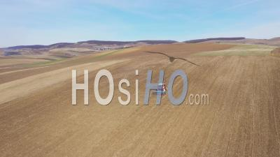 Video Drone Footage Of A Tractor Plowing The Field By Drone