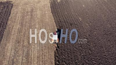 Video Drone Footage Of A Tractor In Agricultural Field