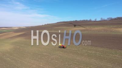 Video Drone Footage Of Agricultural Field, Meadow And A Tractor