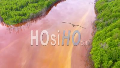 Drone View Of Waste Water From A Copper Mine Flooding Nature And Green Forest
