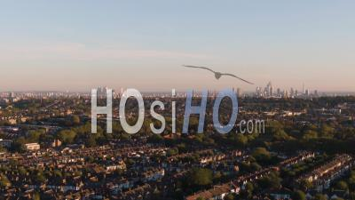Aerial Dolly View Of A Typical Victorian Village (crouch End) And The Skyline Of The City Of London - Video Drone Footage