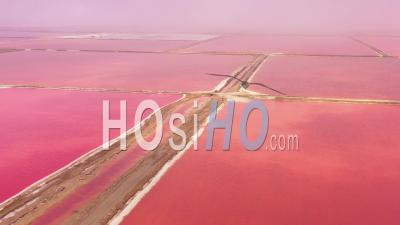 Aerial View Over Bright Red And Pink Salt Pan Farms Near Walvis Bay, Namibia - Drone Point Of View