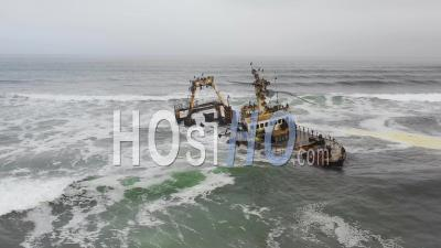Dramatic Aerial View Over A Spooky Shipwreck Grounded Fishing Trawler Along The Skeleton Coast Of Namibia - Drone Point Of View