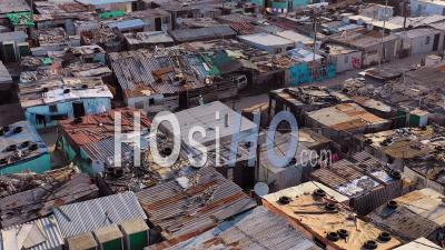 Aerial View Over Ramshackle Tin Roofs Of Gugulethu, One Of The Poverty Stricken Slums, Ghetto, Or Townships Of South Africa - Drone Point Of View