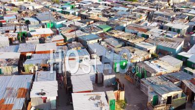 Aerial View Over Ramshackle Tin Roofs Of Gugulethu, One Of The Poverty Stricken Slums, Ghetto, Or Townships Of South Africa - Video Drone Footage