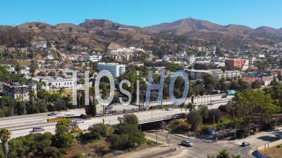 Aerial Video Drone Footage Of Southern California Beach Town Of Ventura, California With Freeway Foreground And Mountains Background