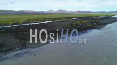 Aerial View Of A Glacial River In A Remote Highland Region Of Iceland - Video Drone Footage