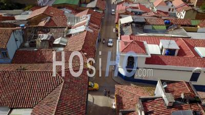 Aerial View Of Old Buildings, Modern Skyscrapers And Neighborhoods In Downtown Bogota, Colombia - Video Drone Footage