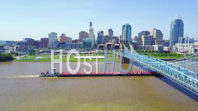 Aerial View Of Cincinnati Ohio With Bridge With A Barge On The Ohio River - Video Drone Footage