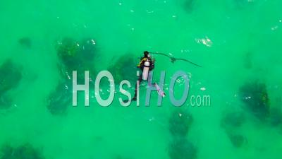 Aerial View Over A Scuba Diver Swimming To A Buoy In Open Ocean Waters - Video Drone Footage