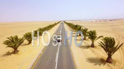 Aerial View Over A 4 Wd Jeep On A Road Near Swakopmund, Skeleton Coast, Namibia, Africa - Drone Point Of View