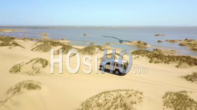 Aerial View Over A 4wd Safari Jeep Vehicle Driving Across The Sand Dunes And Skeleton Coast Of Namibia, Africa - Video Drone Footage