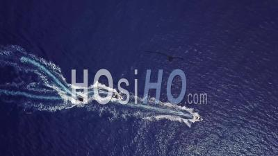 Aerial View Looking Straight Down Of Three Speedboats Motor Boats Zig Zagging On The Ocean Or Sea Suggesting Water Sports Fun And Adventure - Drone Point Of View
