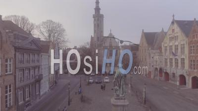 Aerial View Of A Mysterious Foggy Day Through A Central Square In Bruges, Belgium - Video Drone Footage