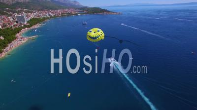 Aerial View Over Parasailing Near Hvar On The Adriatic Coastline, Croatia - Video Drone Footage