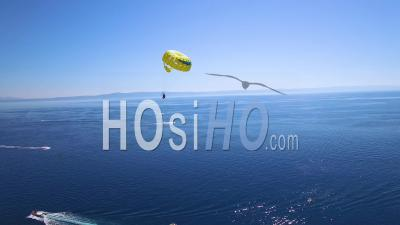 Aerial View Over Parasailing Parasailors Near Hvar On The Adriatic Coastline, Croatia - Drone Point Of View