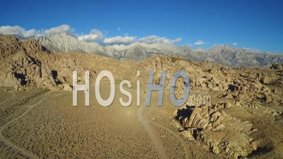 Aerial View At Sunset Over The Alabama Hills Outside Lone Pine California With Mt. Whitney And Sierras Background - Video Drone Footage
