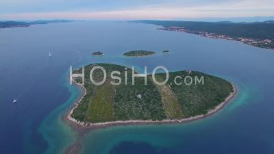 Aerial View Over A Heart Shaped Island In The Adriatic Sea Off Croatia - Video Drone Footage