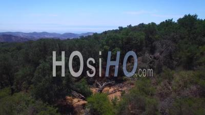 Aerial View Over The Tops Of The Santa Ynez Mountains Near Santa Barbara Reveals The Pacific Ocean Distant - Video Drone Footage