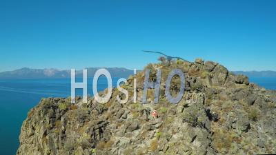 Aerial View Over A Hiker On A Mountaintop In Lake Tahoe, Nevada - Drone Point Of View