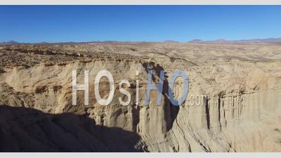 Aerial View Over A Beautiful Dry Cliff Face In The Remote Mojave Desert Of California Or Nevada - Video Drone Footage