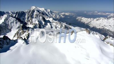 Slow Flight Over Sharpspined Ridges In The French Alps