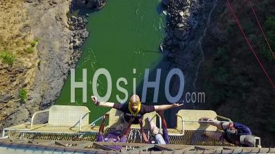 Aerial View Of A Man Bungee Jump Off A Bridge In Zambia Zimbawbwe Africa - Video Drone Footage