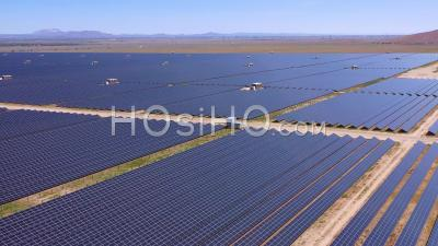 Aerial View Of Vast Solar Panels And Solar Power Fields, Clean Energy Solution, In The California Desert Near Antelope Valley - Video Drone Footage