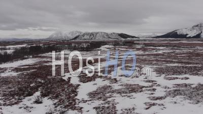 Aerial View Over A Desertic Frozen Landscape. A Troundra Landscape In The Lofoten Islands
