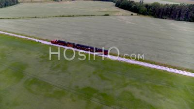 Aerial, Old Style Train On Train Track With Open Fields - Drone Point Of View
