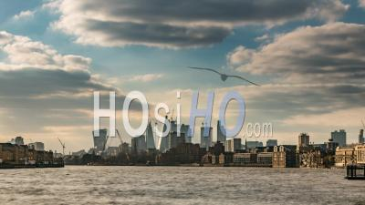 The Skyline Of The City Of London Across The River Thames With Clouds