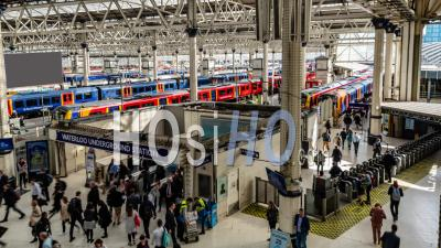 Waterloo Station In London At Rush Time With Commuters And Shoppers