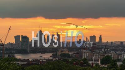 The Skyline Of The City Of London Across The River Thames At Sunset