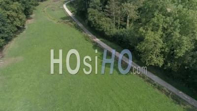 A Bike Passing On A Path In The Countryside Near Coutances - Drone Point Of View