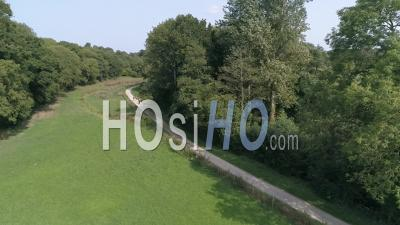 Walkers On A Path In The Countryside Near Coutances - Video Drone Footage