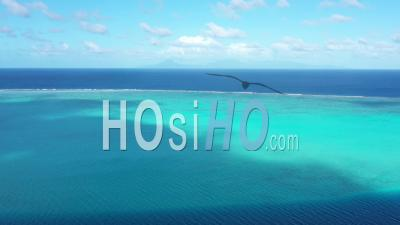 Aerial View Of A Coral Barrier In French Polynesia - Drone Point Of View