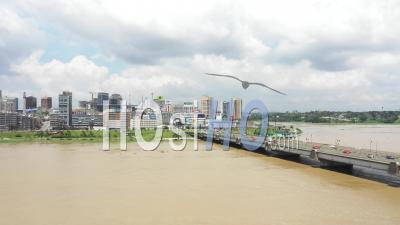 Abidjan City And The Bridge Houphouet Boigny Leading To Abidjan Plateau - Video Drone Footage