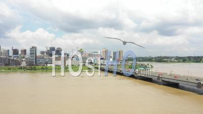 Abidjan City And The Bridge Houphouet Boigny Leading To Abidjan Plateau - Video Drone Footage