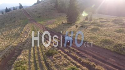 Off-Road Car Driving On A Mountain Dirt Road - Video Drone Footage